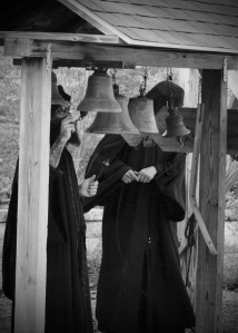 Monks ringing bells, call to worship.