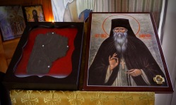 Fragment of Gospel Book cover from St Herman Monastery, Platina; recovered from the fire which destroyed the first chapel, following Fr Seraphim Rose's repose in 1982. This Gospel cover was originally from Optina Monastery in Russia! The icon is of Elder Ambrose of Optina.