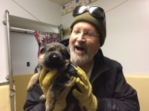 Br. Gregory with a 3-week old puppy...