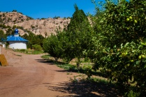 Fruit trees line the walk to the chapel.