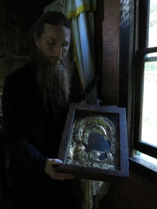 Fr Andrew of St Michael's Skete holding the Kaluga Icon of the Mother of God, in the Kaluga Chapel.