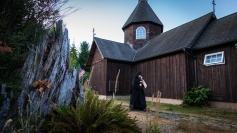 A monk sounds the call to Matins on the semantron. All-Merciful Saviour Monastery, Vashon Island WA
