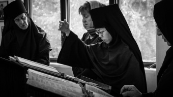 Directing the monastic choir.
