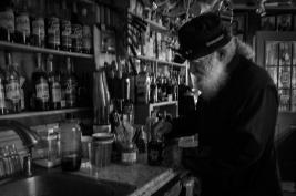 Monk Ignatius prepares coffee for a pilgrim,
